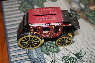 old metal piggy bank Wells Fargo and Union Trust Co. stagecoach San Fransisco
