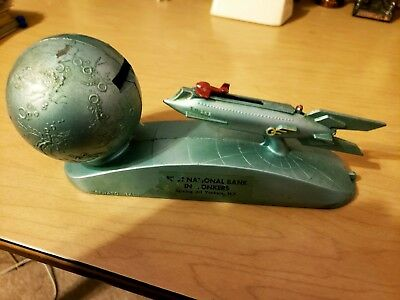 Vintage metal Strato Bank rocket works green