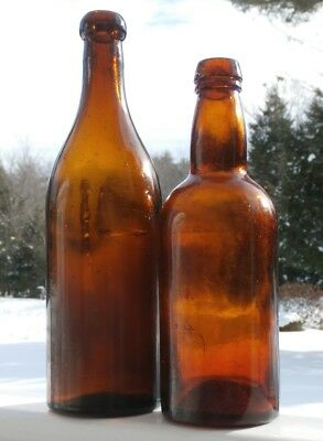 PAIR OF EARLY ANTIQUE BASE EMBOSSED BLOWN IN MOLD AMBER BEER BOTTLES, 1800's