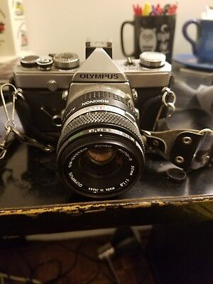 Olympus OM-10 35mm SLR Film Camera with 50 mm lens Kit and additional lens/flash