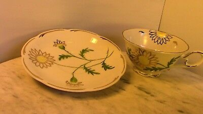 Beautiful Tea Cup and Saucer with Hand-painted Daisies