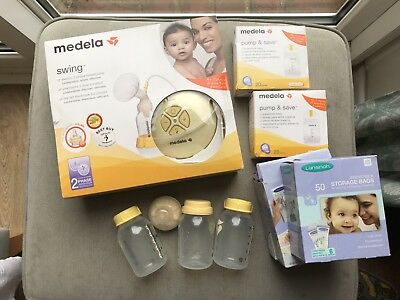 Medela Single Electric Breast Pump, With Extra Bottles And Storage Bags