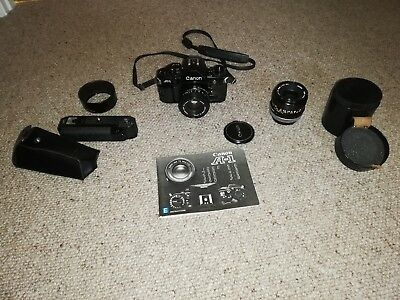 Canon A-1 35mm SLR Film Camera with Power Winder and Canon FD 50 and 35 lens