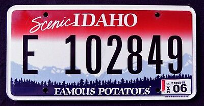 "IDAHO "" FAMOUS POTATOES - SCENIC - MOUNTAINS "" ID Graphic License Plate"