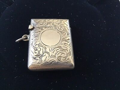 sterling silver vesta case With A Embossed Pattern On It.