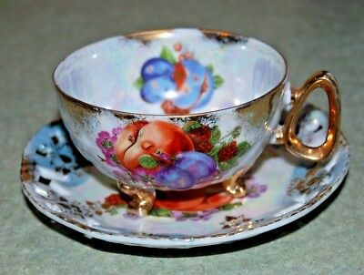 Vintage Tea Cup and Saucer Iridescent 3 Footed Toe Fruit Gold Gilt