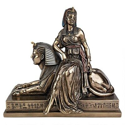 Ancient Egyptian Queen Cleopatra Resting on the Iconic Sphinx Sculptural Decor