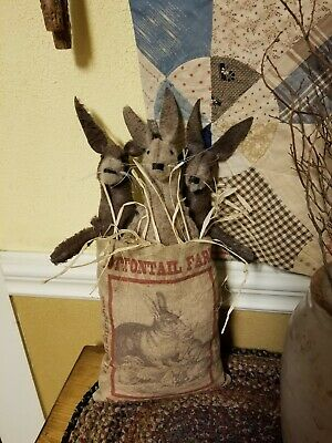 Primitive Bunnies In Sack With Feedsack Print