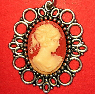 Silver Plated Pendant With A Victorian Bride Cameo And  Coral Colored Background