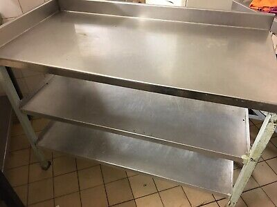 Stainless Steel Table With 2 Shelves Underneath.