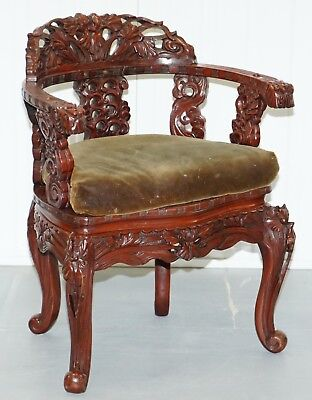 Vintage Chinese Red Lacquered Carved Elm Armchair With Heavy Foliage Detailing