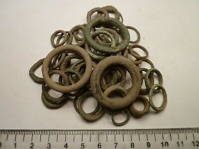 4095	Lot of 48 bronze ancient Celtic pre-coin currency; ring money