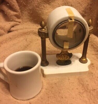 antique small clock marble case and brass trim. No Movement