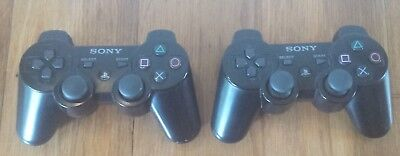 Pair of Sony Playstation 3 Black Sixaxis Wireless Controllers CECHZC1U