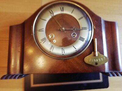 A collection of various mantle clocks plus one wall clock