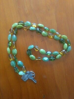 """""""Tree of Life"""" lanyard made from vintage green bead necklace and silver charm."""