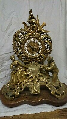 Victorian gilt/bronze French Style Ormolu Clock on a brown marble base