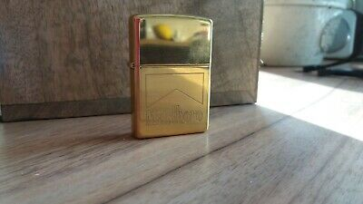 Collectable Solid Brass engraved Marlboro gold finish Zippo Lighter, new in box.