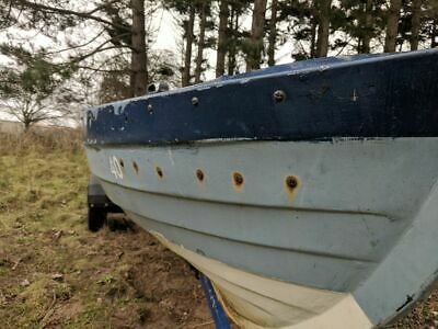A characterful mock Clincker GRP ex sailing Dinghy with trailer