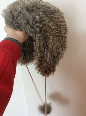 faux fur winter hat with pom poms never been worn