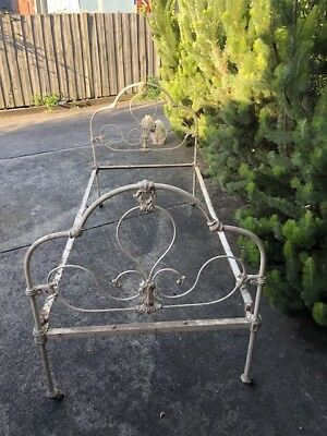 Graceful genuine antique wrought iron single bed