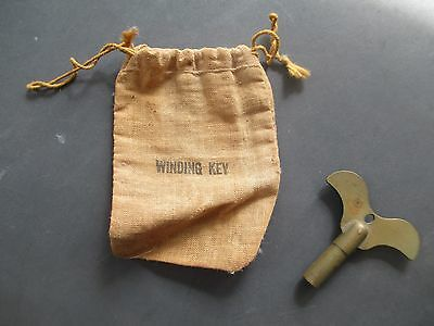 RARE antique RAVEN WING - SHAPE brass clock WINDING KEY original CLOTH - BAG