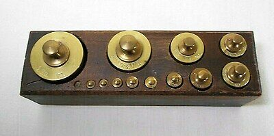Set Of 12 Vintage Brass Scale Weights In Wood Holder. Marked In Grams, V. L.