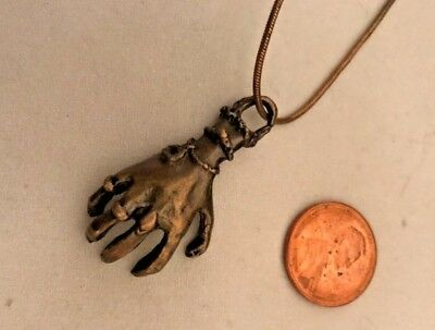 "Antique Gold costume necklace with metal creepy hand on a 18"" long chain"