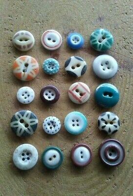 Antique lot of 20 different stencil and calico china clothes buttons.