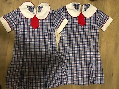2 school uniform girl Harrison School ACT size 4, will fit side 5 as well.