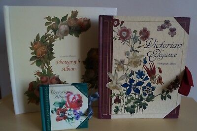 Three vintage Victorian Style Photo albums with floral patterns