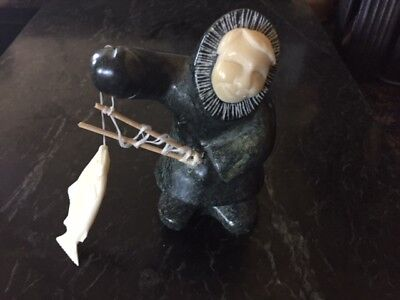 very collectible Eskimo art craft,sculpture signed by artist