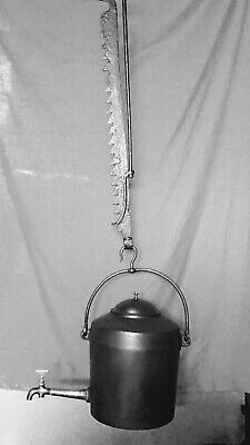 A Kenrick Cast Iron Hearth Kettle/Water Cistern With Adjustable Trammel Pot Hook