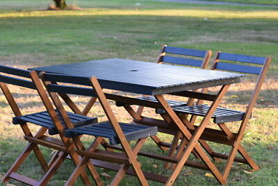 Hard Wood Outdoor Dinning Set One Table and 4 Chairs able to Hold a Parasol