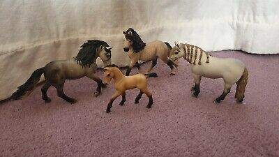 A Family of Four Schleich Andalusian Horses. Very good condition.
