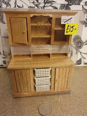 Dolls house furniture. Kitchen cabinet with mesh drawers.