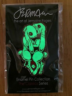 WE CARRY EACH OTHER LIMITED EDITION GID ENAMEL PIN JERMAINE ROGERS GLOW IN DARK