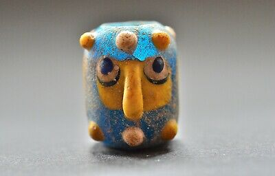 Phoenician glass double headed face bead pendant, 5th - 4th century BC.