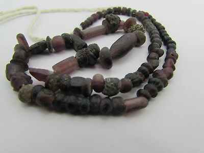 Ancient Roman Glass rare tiny beads of string in garnet colors From Afghanistan