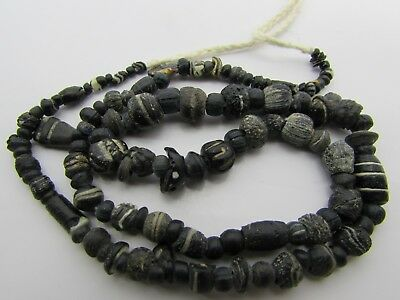 Ancient Roman Glass rare tiny beads of string in black colors From Afghanistan.