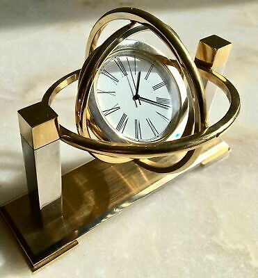 Beautiful Giro Style With Moving Loops Brass Clock