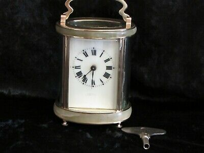 Vintage oval carriage clock