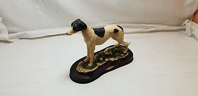 The Juliana Collection Single Greyhound standing on a mounted base