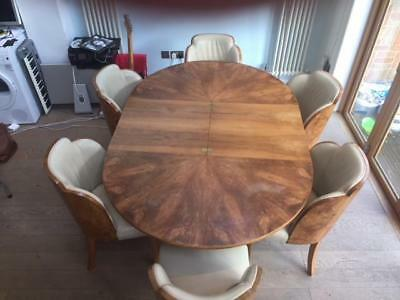 Art deco dining suite with six Epstein cloud back cream leather chairs,