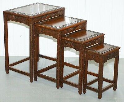 Chinese Export Circa 1930'S Nest Of Four Tables Heavily Carved All Over In Teak