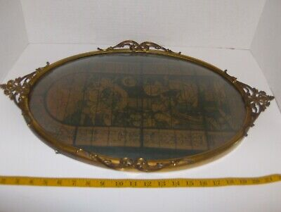 Large vintage oval metal gilt frame with convex glass
