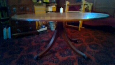 Oval reproduction wood table with claw feet on castors