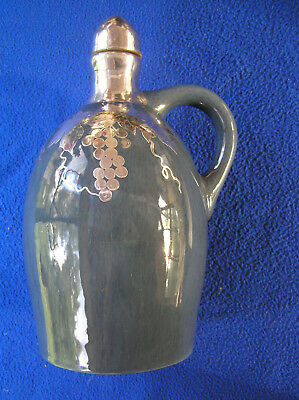 Fulper sterling silver overlay ceramic wine  jug/music box