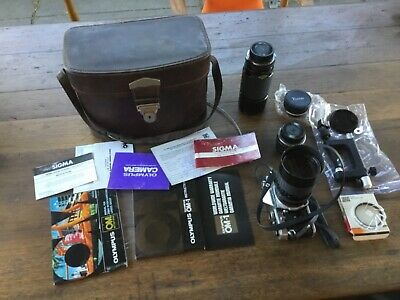 OLYMPUS OM 1 CAMERA 35 mm lenses pamphlets case accesories all as pictured