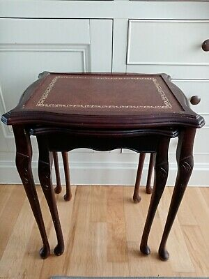 Vintage Wooden Set Of 2 interlocking Nest of Tables Brown and Gold leather tops.